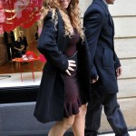 Mariah Carey and Nick Cannon Kiss For The Cameras