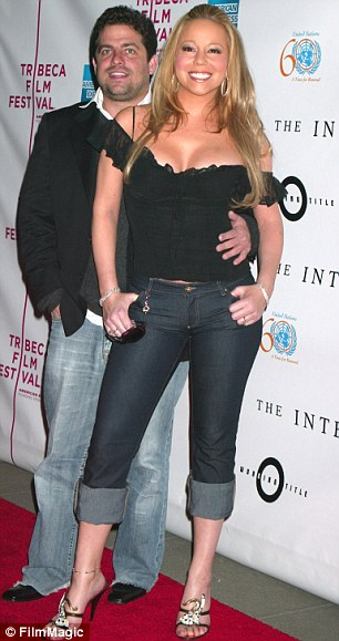 1411280134899_Image_galleryImage_Brett_Ratner_and_Mariah_C